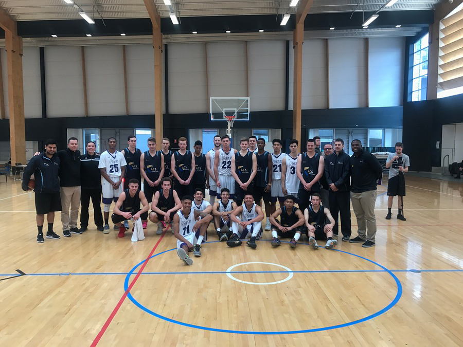 Both the Australian and United States basketball teams coming together for a photo.