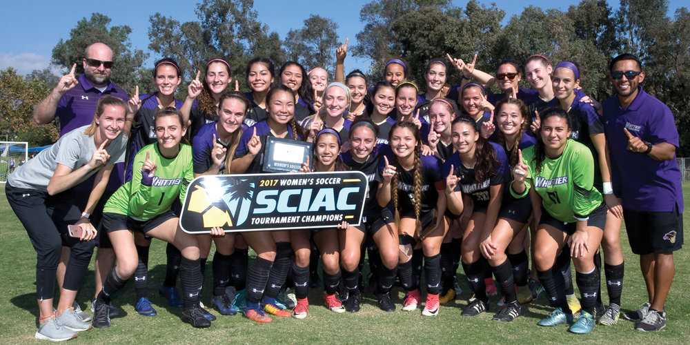 Women's Soccer huddles in tight for a celebratory group photo.