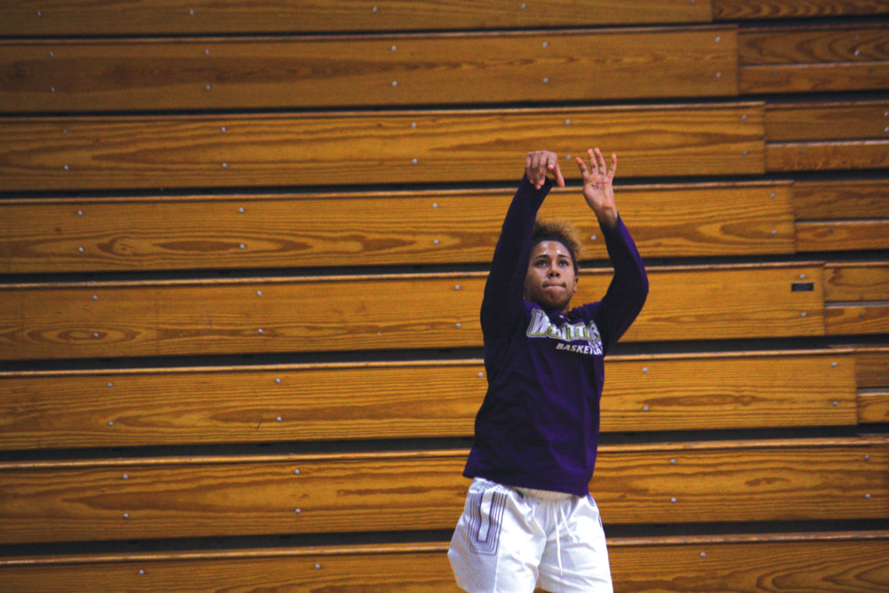 Second-year guard Cali Cubel practices following through and keeping her eye on her shot.