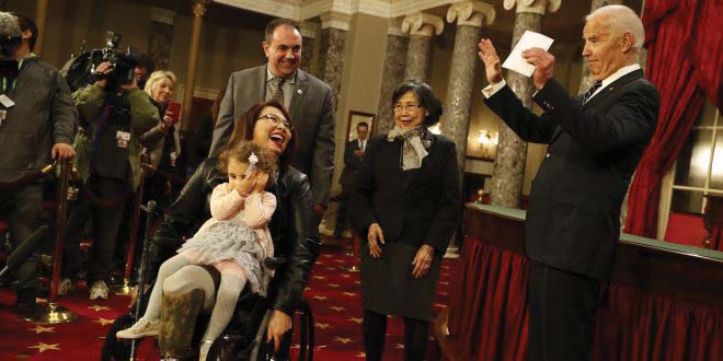 Senator Tammy Duckworth and her daughter greet press.  COURTESY OF  FLICKR.COM