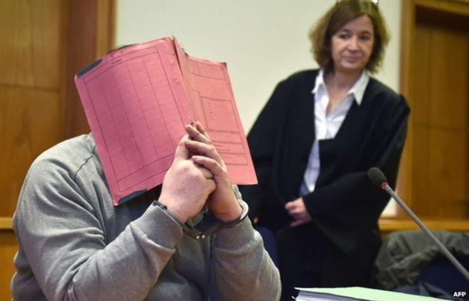 Killer nurse covers his face in shame at trial.   COURTESY OF  BBC.COM