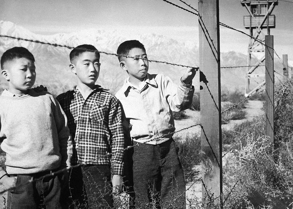 Three Japanese-American children photographed in an internment camp during WWII.  Photo courtesy of  Argunners Magazine
