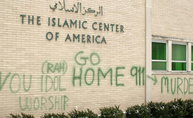 Graffiti on the walls of The Islamic Center of America.   Photo Courtesy of Getty Images