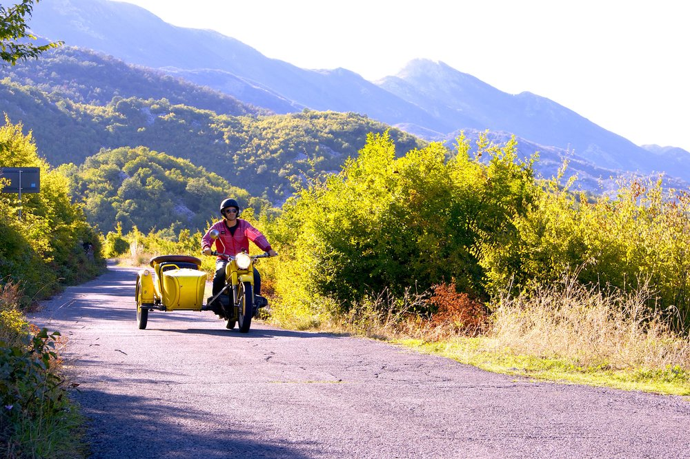 "Leon travelling the countryside of Montenegro in 'Kindness 1' on the route of ""The Kindness Diaries"""