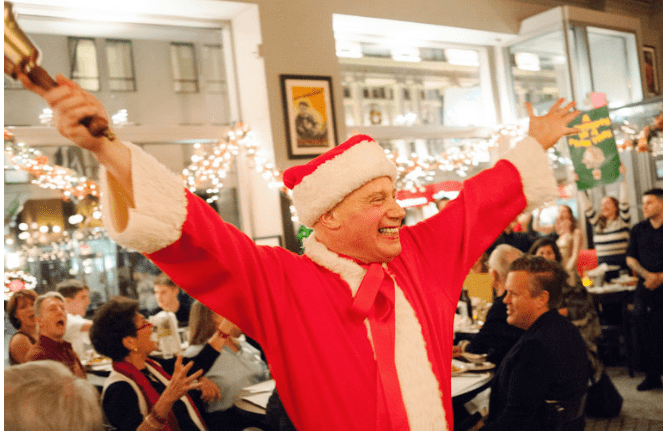 Michael Pollard leading our dining room in our annual 12 Days of Christmas extravaganza