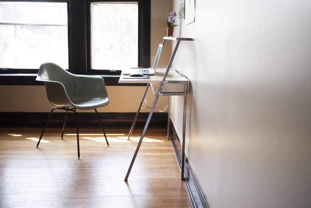 The angled legs keep your knees bruise-free and desk has minimal visual weight in the room.