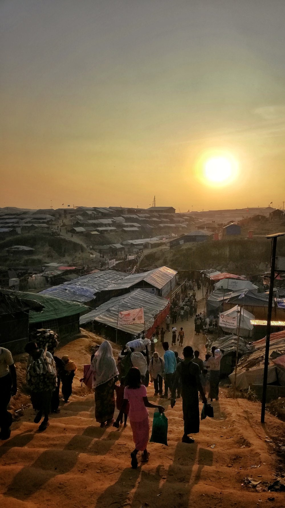 Bangladesh, walking toward a setting sun - settlement, 2018.jpeg