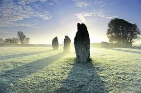 Standing Stone of Avebury on a frosty morning sunrise.