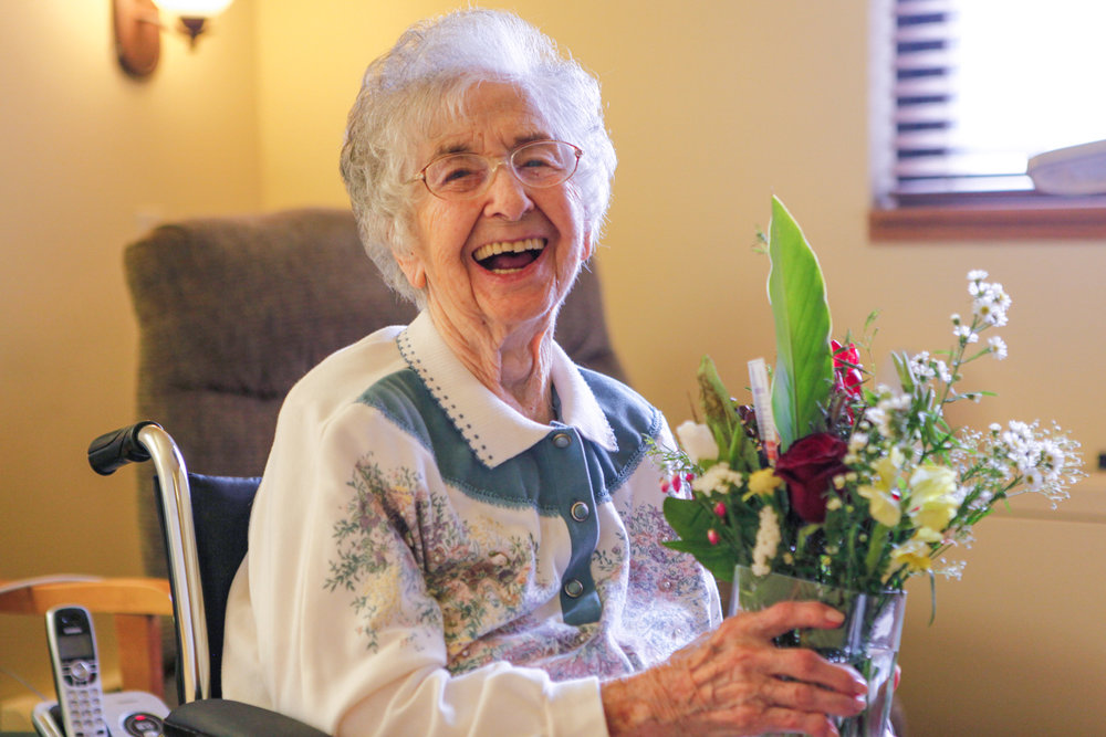 elderly-woman-with-flowers.jpg