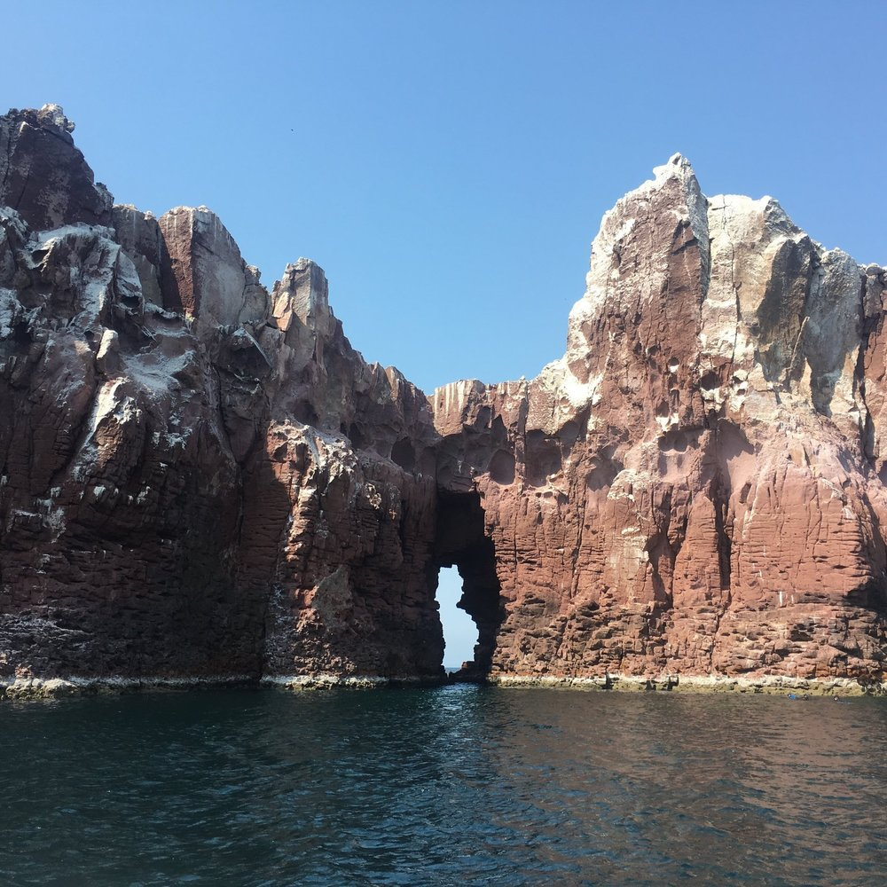 Arch in the red rocks of the Sea of Cortez off La Paz, Mexico | Watson & Walls