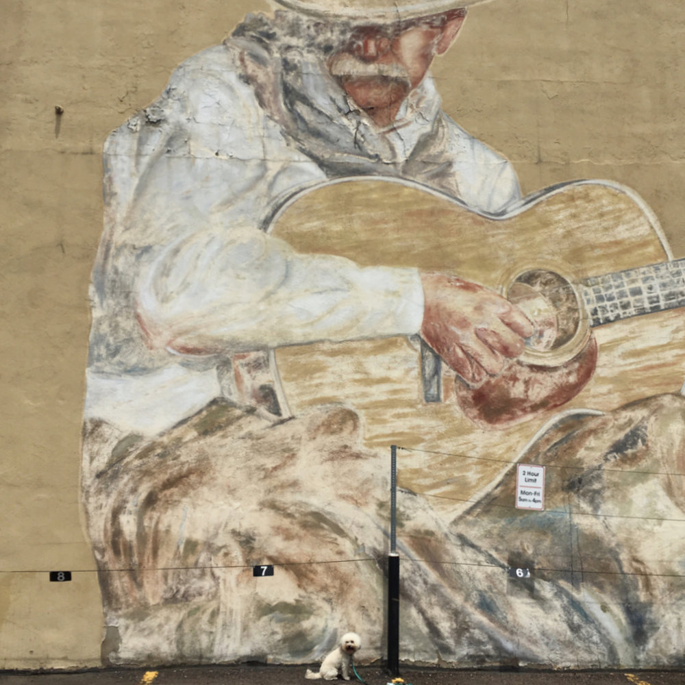 Man with Guitar mural in Denver, CO | Watson & Walls