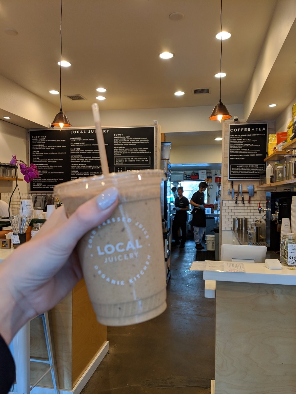 Having a smoothie at Local Juicery in Sedona, AZ | Watson & Walls