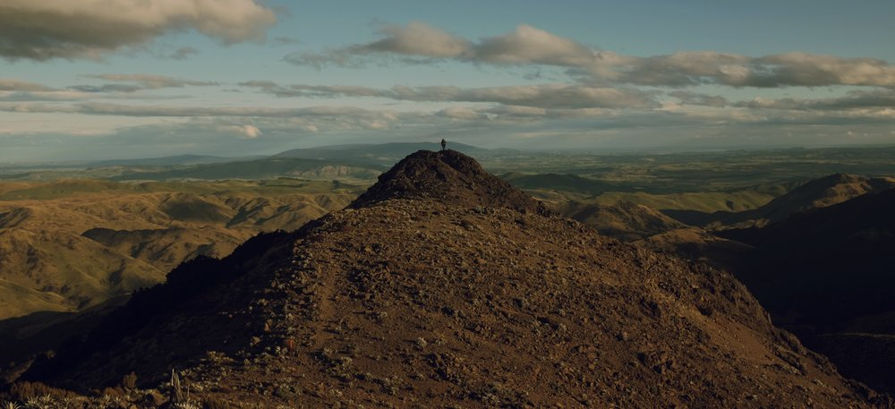 Andrew stands above the vast expanse of New Zealand's Southland.