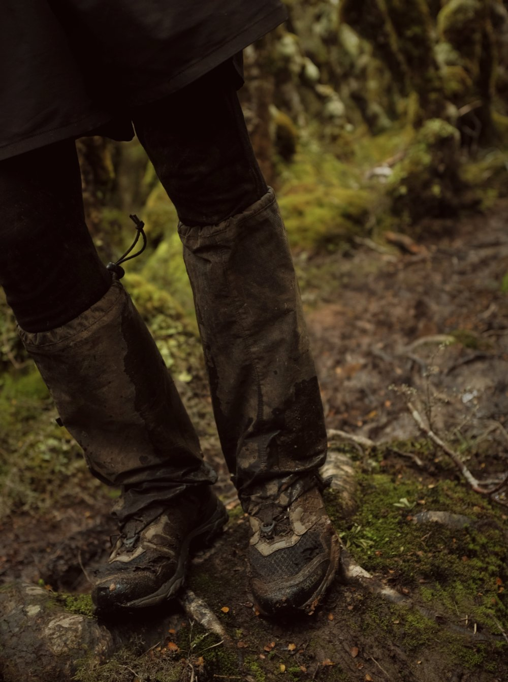 Ripped, muddy, and wet.