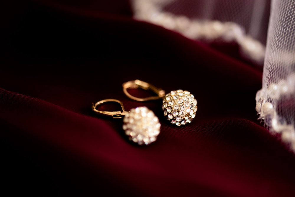 gold and Burgundy wedding, earrings, winter, Kansas videographer