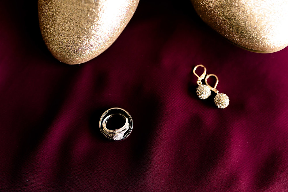 gold and wine winter wedding, rings, jewelry, wedding videographer