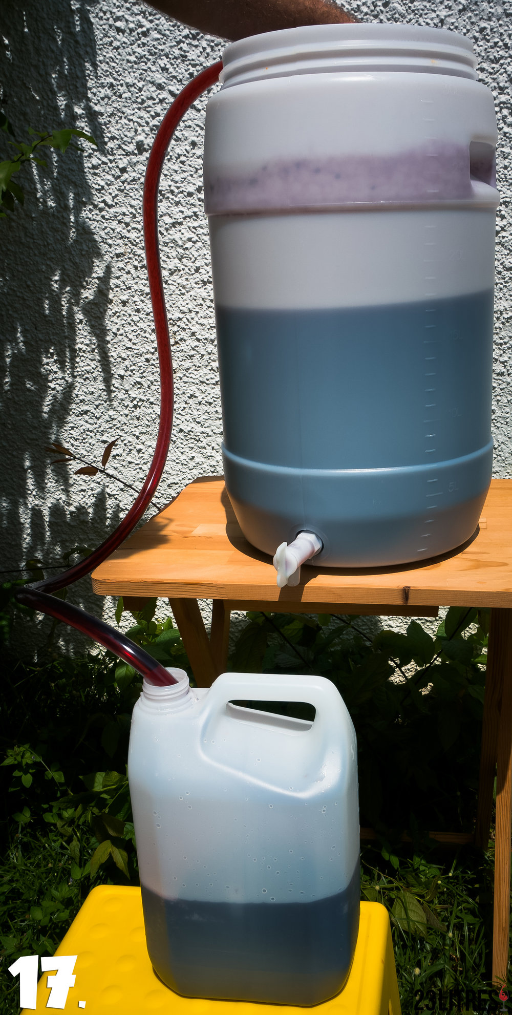 Use a siphon hose to rack the wine from the fermenter to your own bottles.