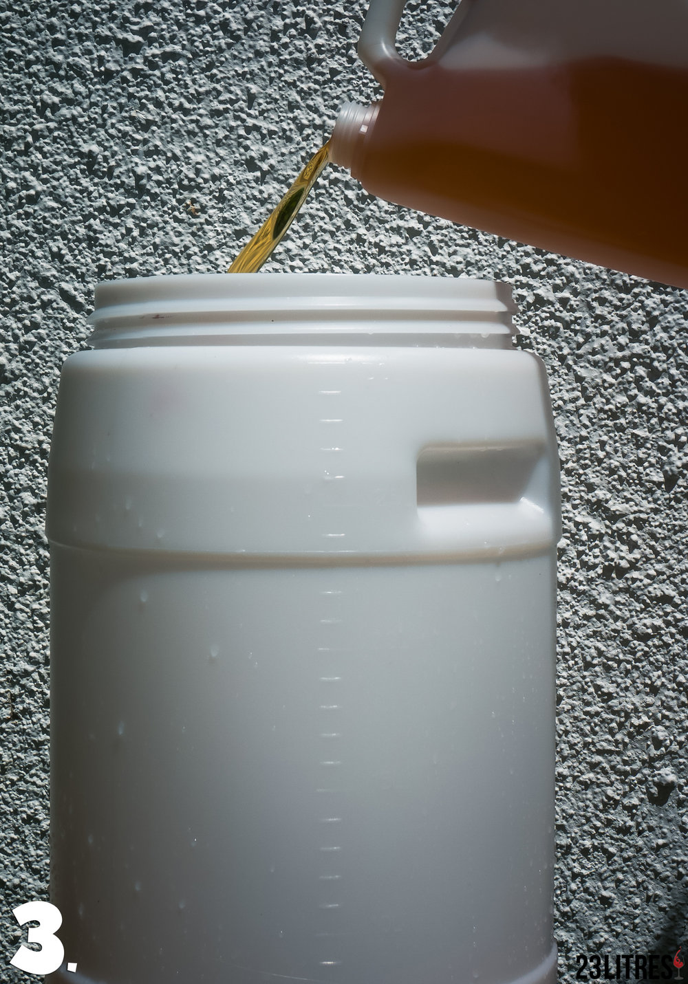 Pour the grape juice concentrate into the 30L fermenter.