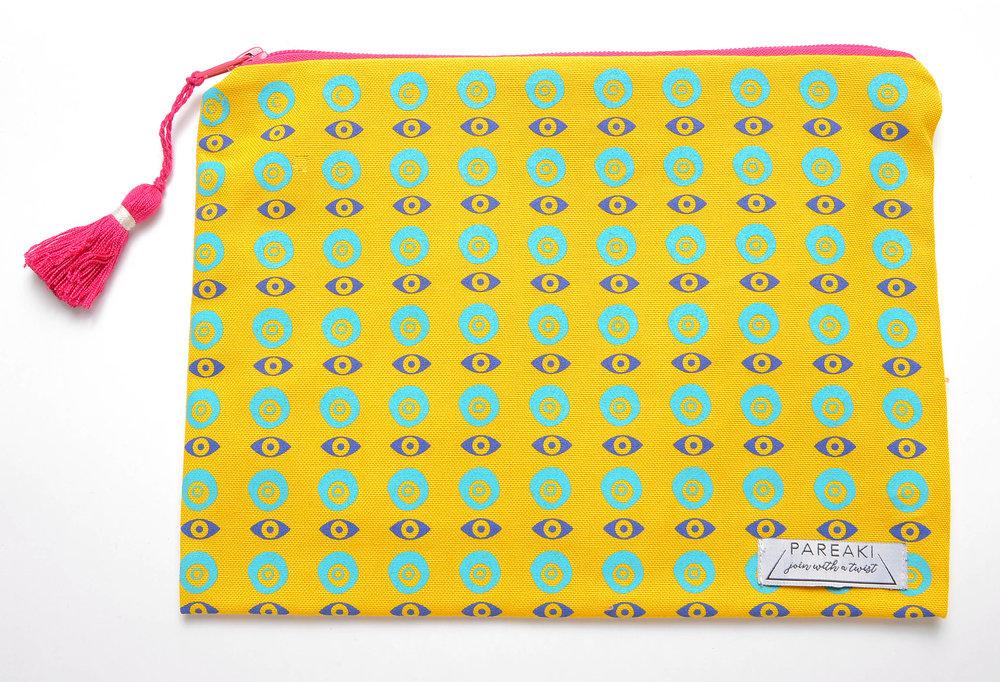 evil-eye-chain-design-on-yellow-canva-clutch-waterproof.jpg
