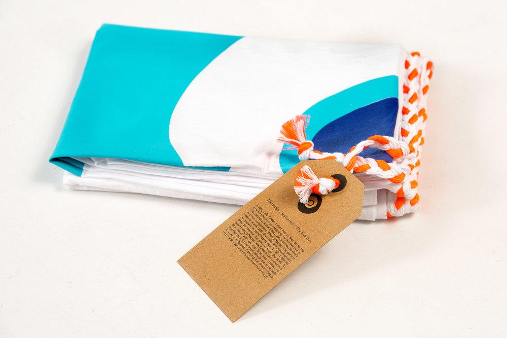 evil-eye-turquoise-kids-pareo-packaging-side.jpg
