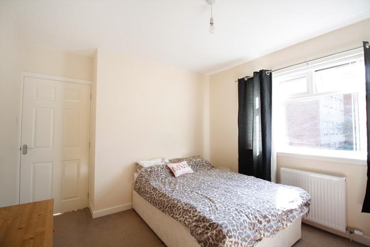 dee-place-bedroom-three.jpg