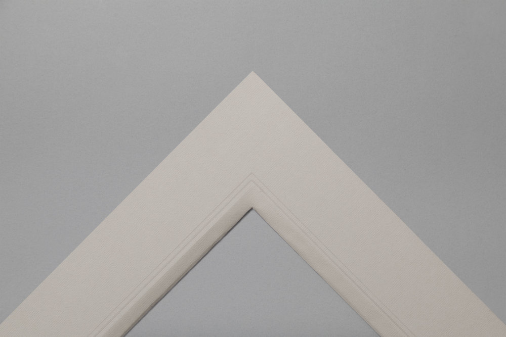 Double thickness, grey paper hand wrapped mount with embossed lines