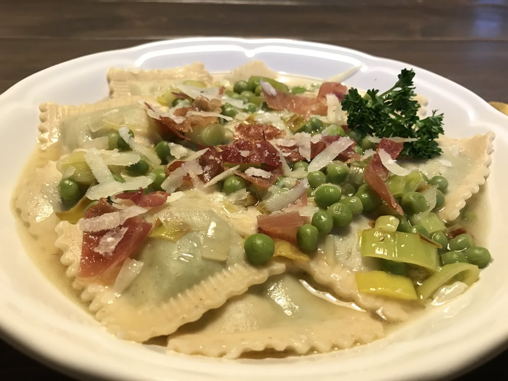 Valicenti Pasta Farm's Sweet Pea w/ Olive Oil Ravioli served with Prosciutto with English Peas, Leeks, & Fresh Parsley Vegetable Broth