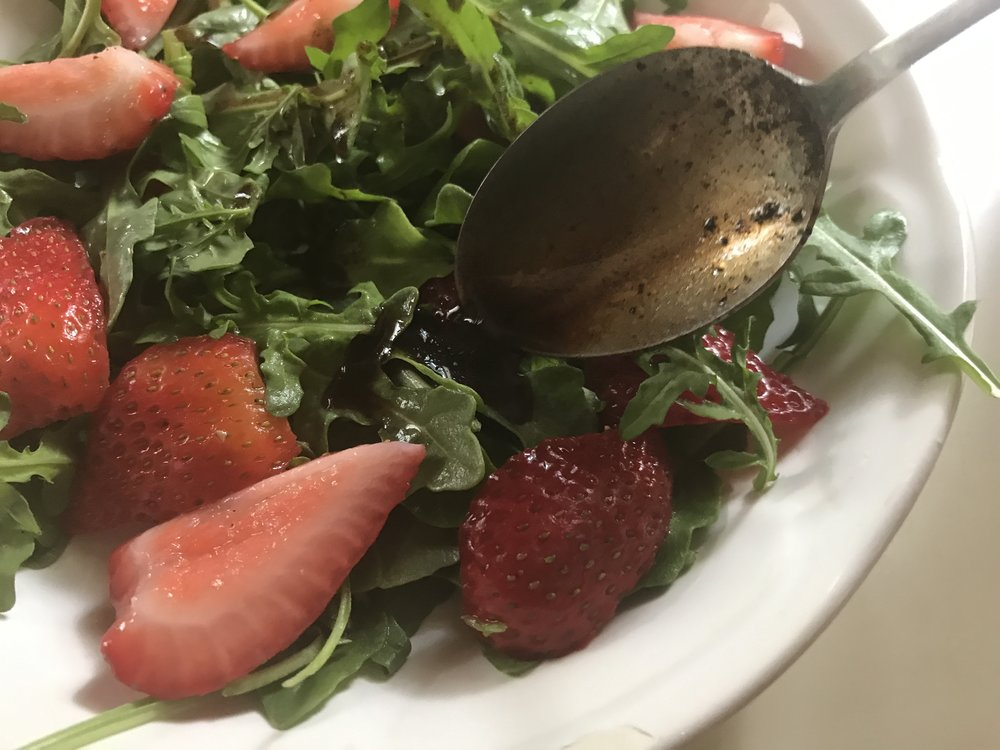 Balsamic Reduction over Arugula and Strawberries.JPG