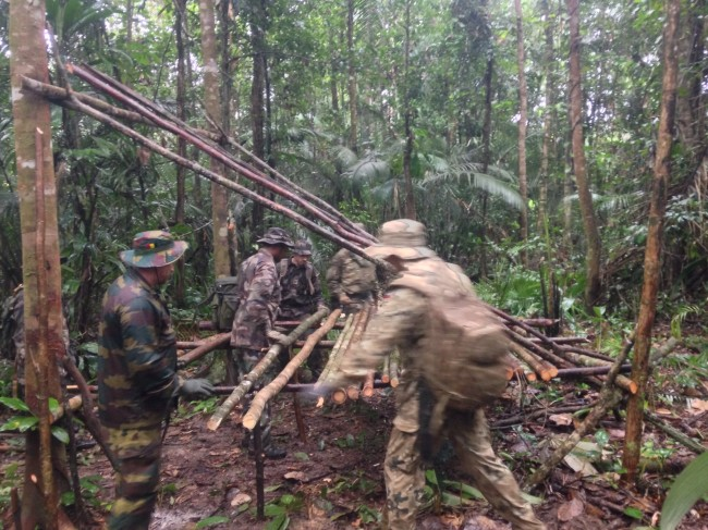 International Jungle Instructors build a team shelter