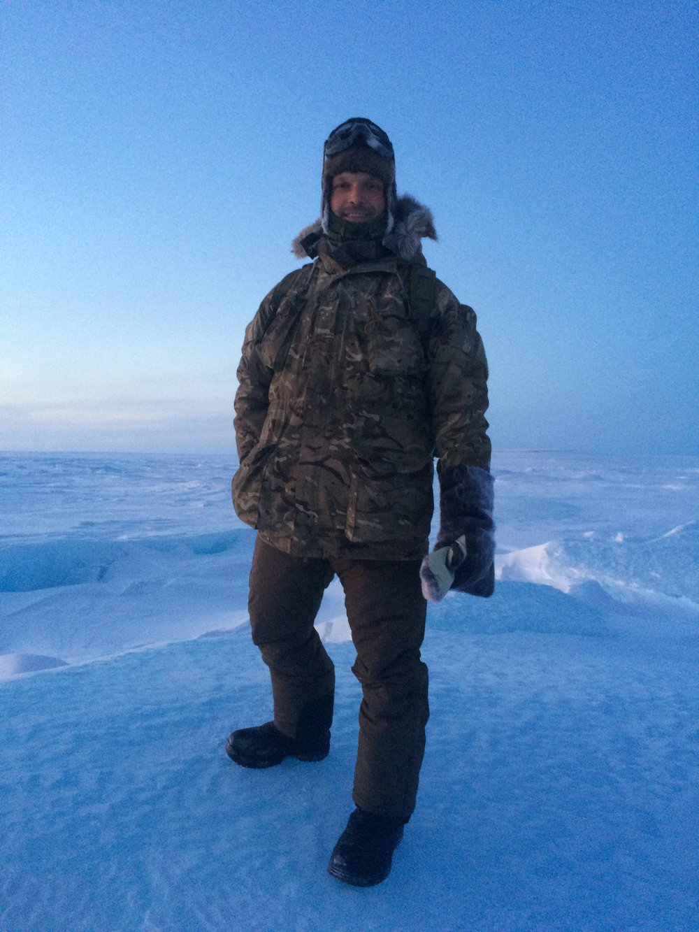 John Hudson wearing Carinthia ECIG (plus UK Mil Smock) stood on the frozen sea of Canada's North West Passage at -65 C (-85F)