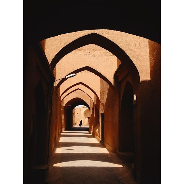 Do people define places or the other way around? #moments #iphonography #ontheroad #wanderlust #architecturelovers #shadowplay #yazd #travel #iran #backpacking #rnifilms
