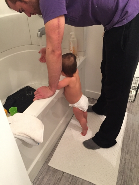 Duke loves to listen to and watch the bathtub fill out! Daddy's little helper!
