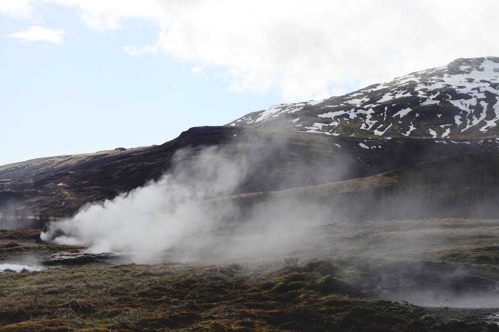 Smoke rising from the smaller baby geysers along the path to the Strokkur Geysir.