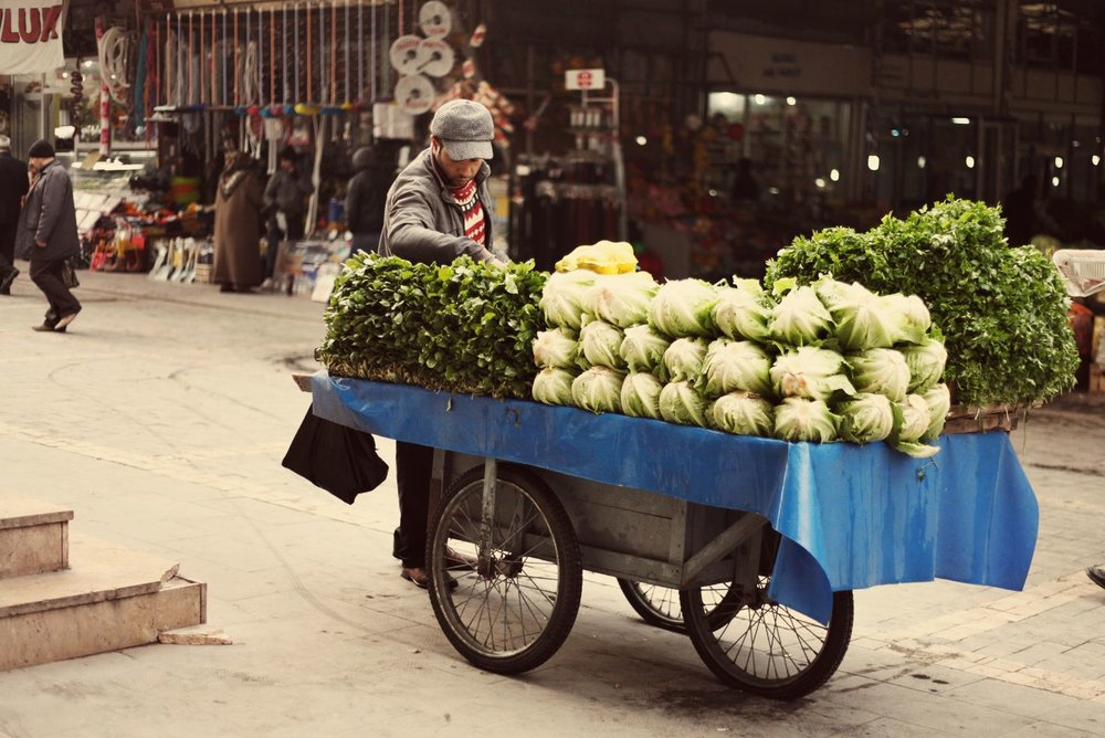 A vendor transports his wares to the bazaar.