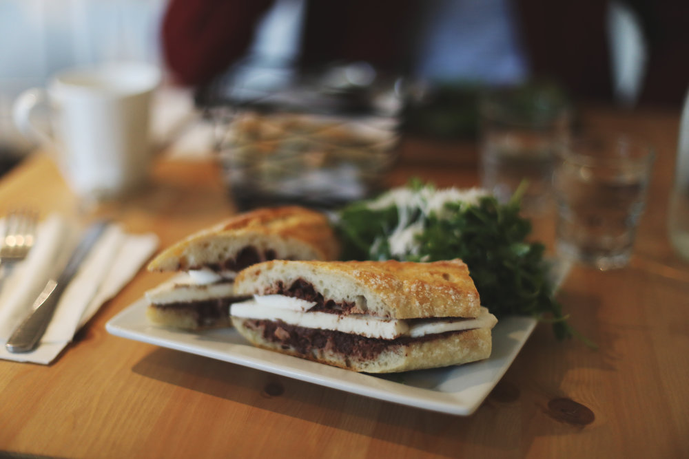 A featured Beacon Pantry sandwich, named after the owner's son since it's his favorite, with fresh mozzarella and olive tapenade.