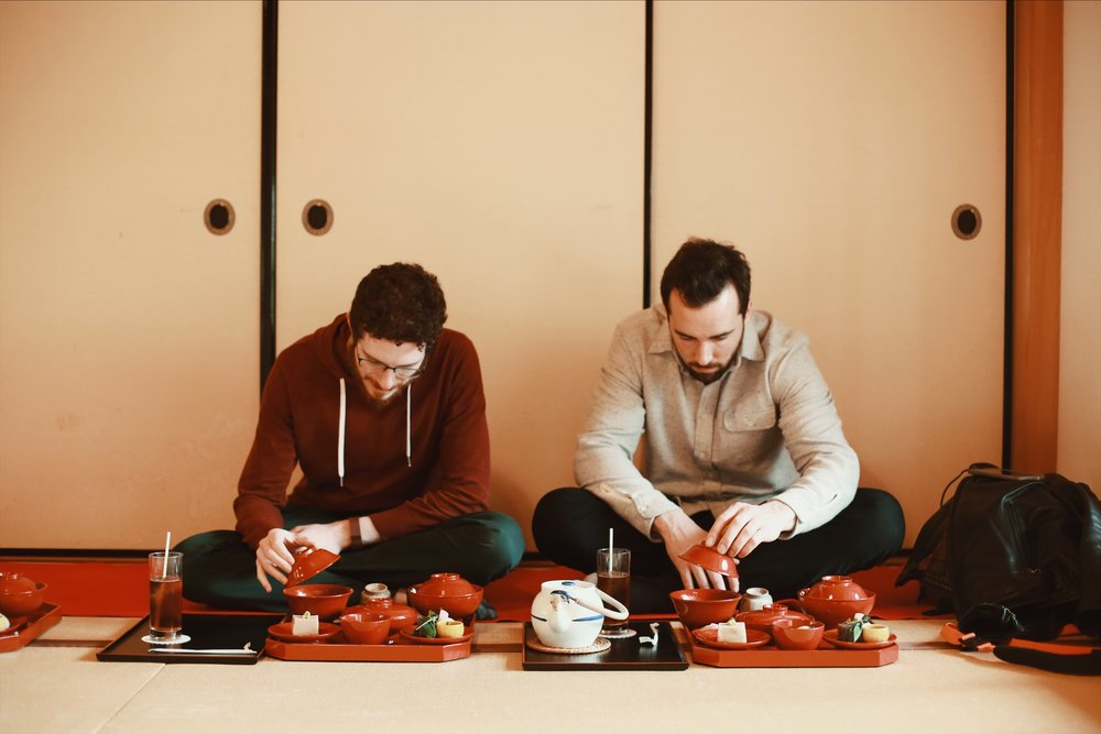 Jeremy and Dennis getting their Buddhist grub on while sitting on the floor in a traditional manner.