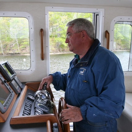 Bill at the helm.jpg