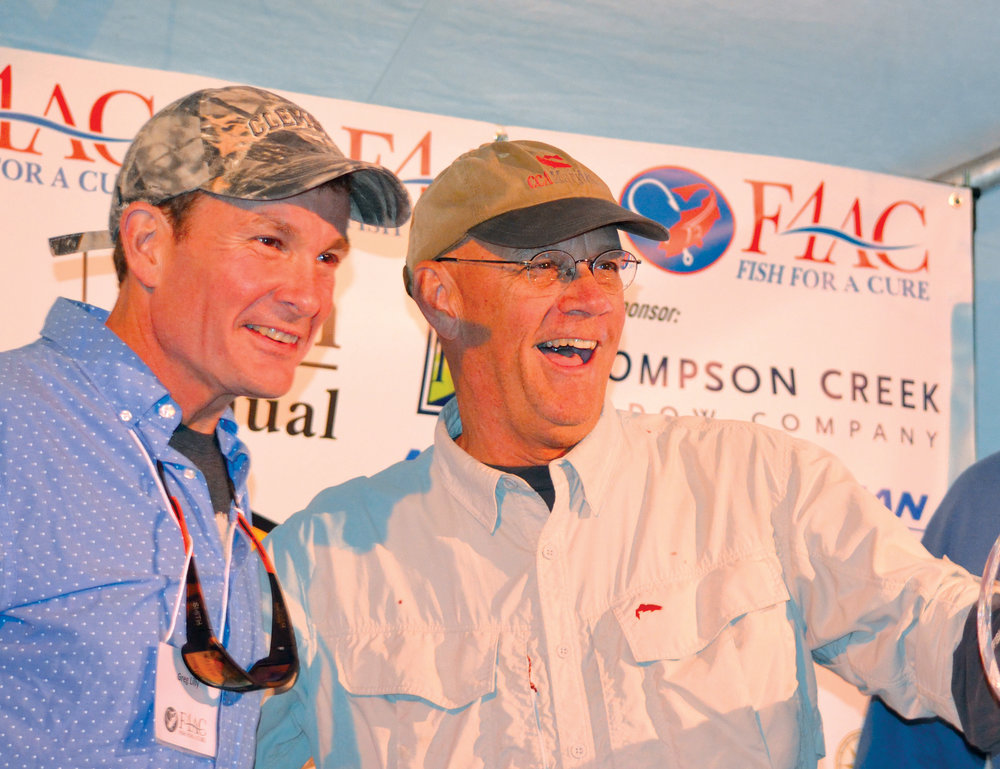 Editor Joe Evans (right) wins big at the 2016 Fish For a Cure