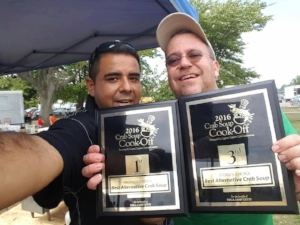 Chef Naz and Joe McGovern at the 2016 Seafood Festival with their winning plaques.