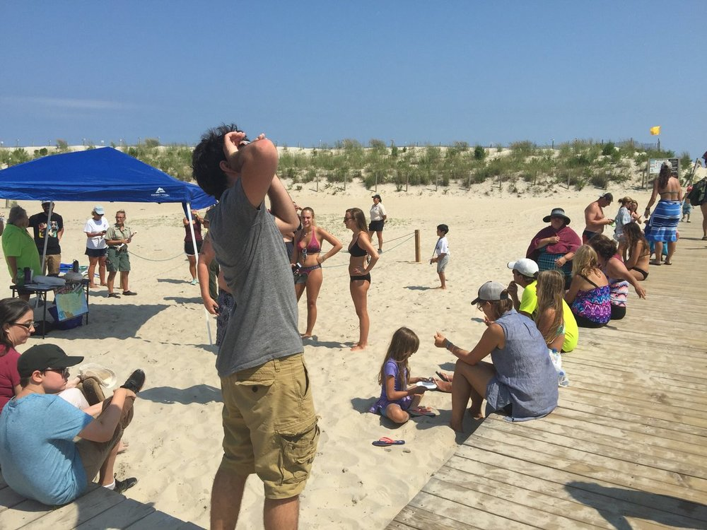 On Assateague Island, visitors took the opportunity to make a beach day out of the viewing party. The park handed out a limited number of pairs of eclipse glasses for people to share.