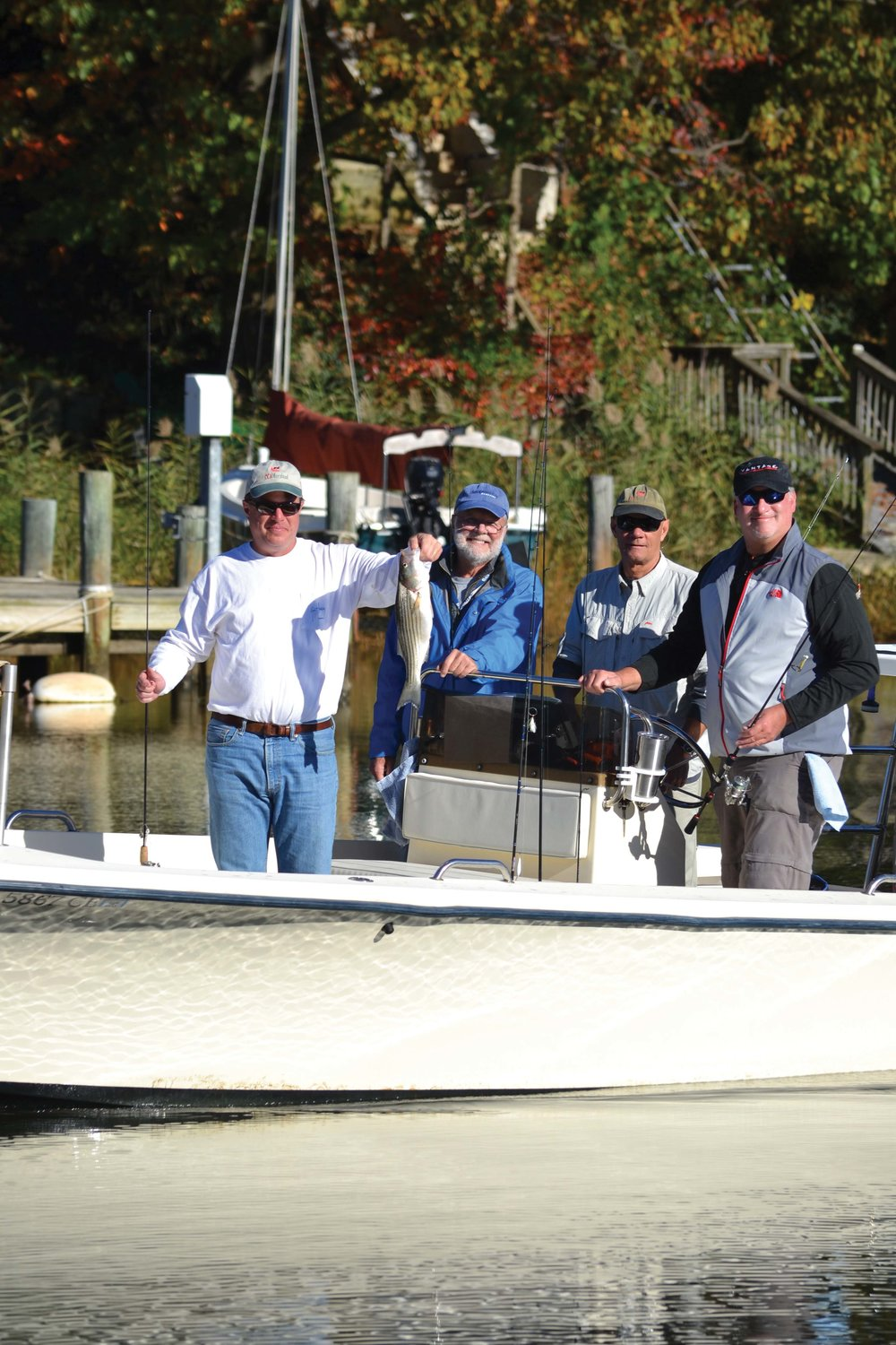 The  CBM  river team prepares to release an undersized striper in the 2016 tournament.