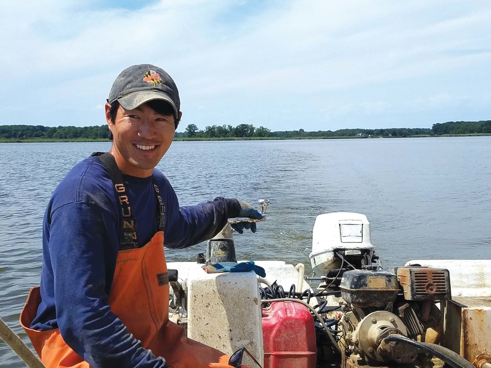 Scott Budden and mate Sean Corcoran on the Chester River, working Budden's oyster lease. Photo by Laura Boycourt.