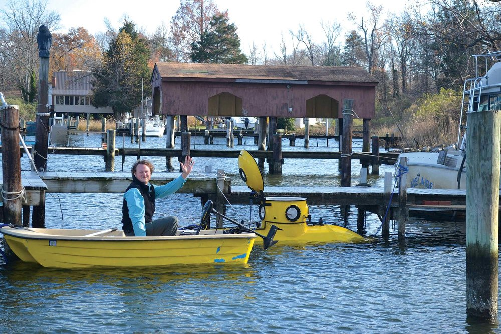 South Riverkeeper Jesse Iliff heads out on the water near the local yellow submarine, which you may remember from the March 2016 cover.