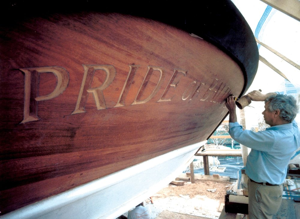 Hecklinger carving the name board on the original Pride. He also carved Pride of Baltimore II's. Photo by Fred Hecklinger.