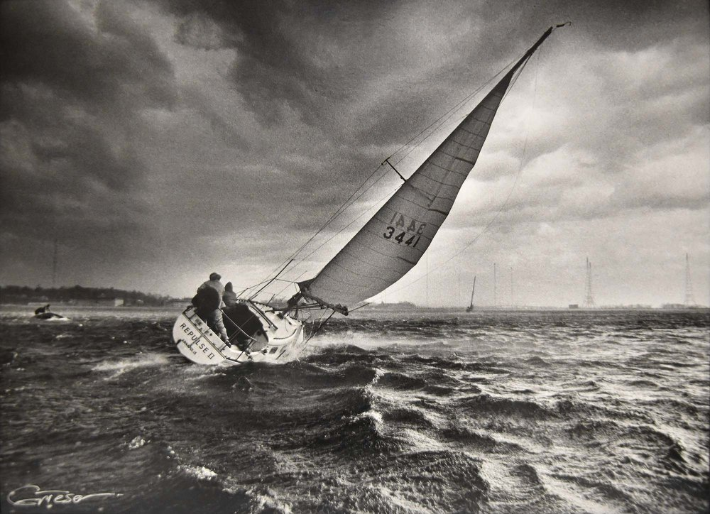 A squall rips through Annapolis Harbor and tears into  Repulse II,  a Yankee 30.  (1976)