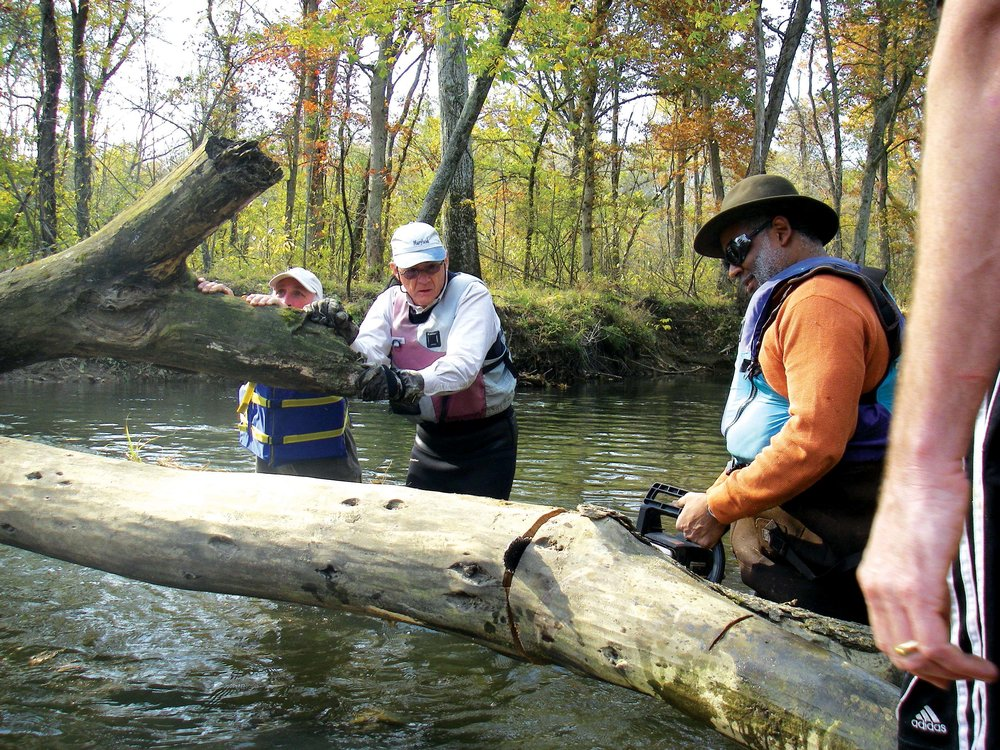 Tutman on the Patuxent with volunteers Ken Hastings and Will Wallace clearing snags. Courtesy of Fred Tutman.