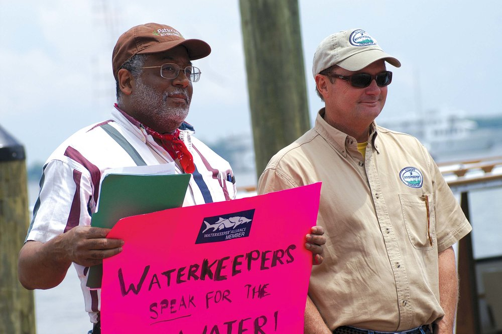 Tutman, protest sign in hand, stands with fellow riverkeepers  protesting the lack of  progress in at the Annapolis City Dock event is Tim Junkin, of the Midshore Riverkeeper Conservancy. Courtesy of Fred Tutman.