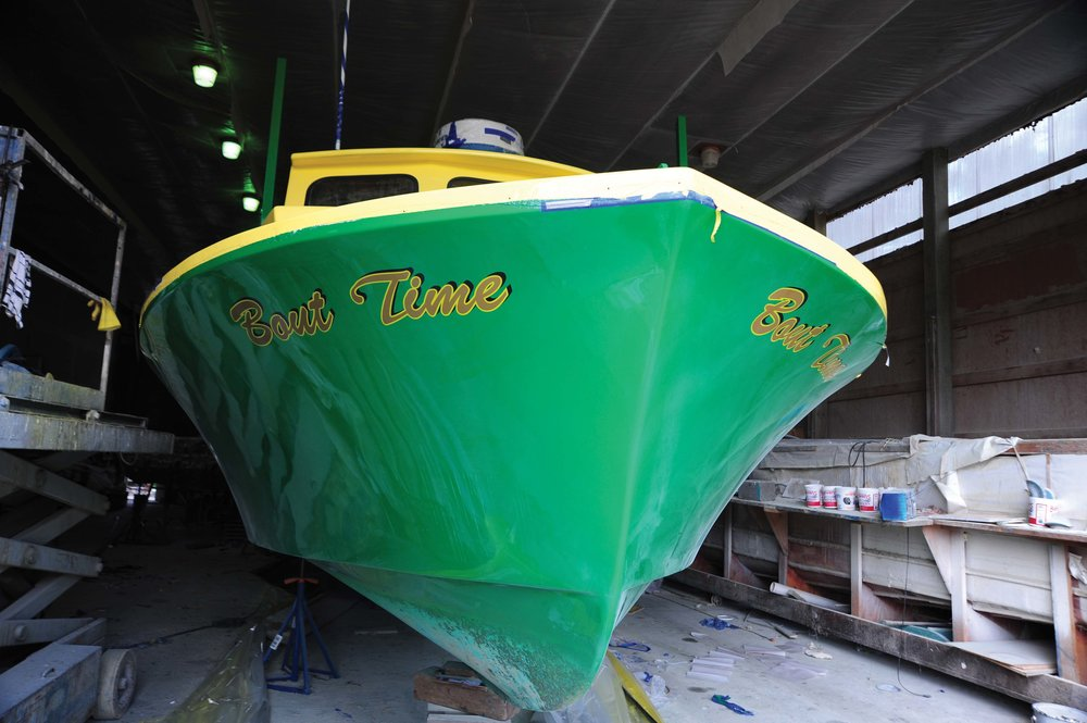 A Bay-built 32-foot Kinnamon deadrise sports new paint in the Evans Boats shed.