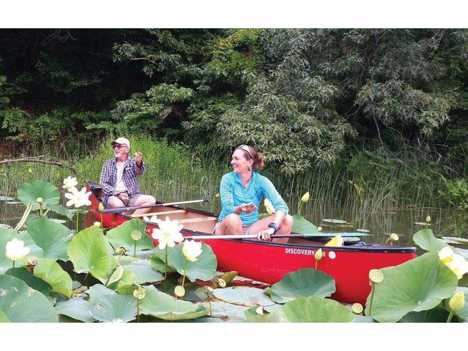 "Gilchrest during lotus season in his Turner's Creek ""classroom."""