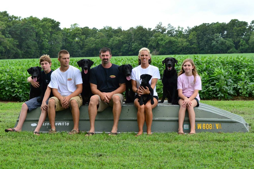 Ryan and Whitney Sayers living the ruff life with their children (from left) Landen, Gavin and Peyton Sayers. Photo by Old Town Retriever Photos